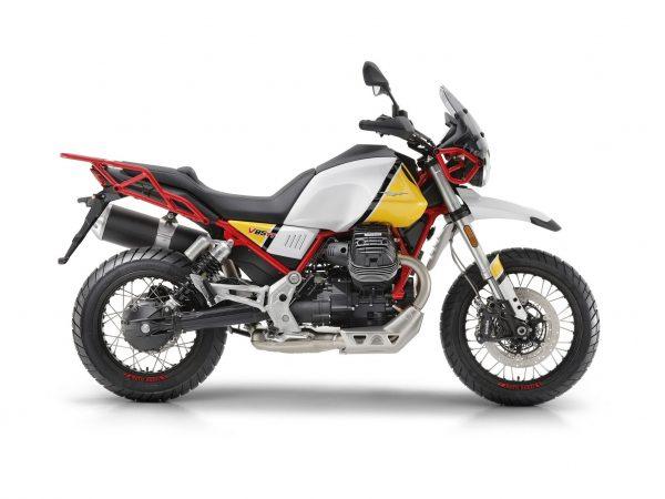 Foto producto Moto Guzzi V85 TT vista lateral izquierdo con detalles en blanco,negro y amarillo