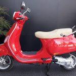 Foto producto Vespa VXL 150 Color rojo. Vista lateral izquierdo